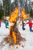 Merry dance around the burning effigy of Maslenitsa Royalty Free Stock Photography