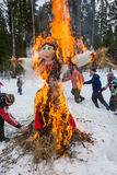 Merry dance around the burning effigy of Maslenitsa, on March 13, 2016. stock images