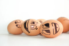 Merry eggs laugh, lie on the surface. Photo Stock Photos