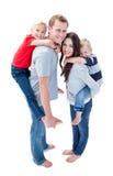 Merry family enjoying piggyback ride Royalty Free Stock Photos