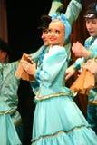 Merry festive Russian folk dances. choreography in the style of the folk holiday Maslenitsa. Stock Photos