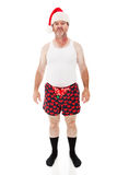 Merry Frickin Christmas. Man in his underwear looking sick, bored, and tired of Christmas. Full Body isolated on white royalty free stock photography