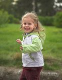 Merry girl. In jacket on autumn Stock Images