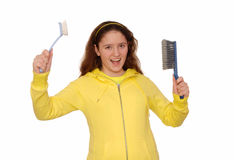 Merry girl holds the blue brushes. Stock Images