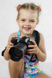 A merry girl keeps SLR camera Royalty Free Stock Photography