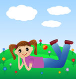 Merry girl lie on green lawn Royalty Free Stock Images