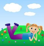 Merry girl lie on green lawn Royalty Free Stock Photo