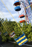 Merry-go-round. Colorful merry-go-rounds in a summer park Stock Photography