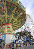Merry-go-round. Illuminated with blue chair, in funfair at paris without people Royalty Free Stock Photography