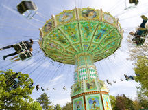 Merry-go-round. Small merry-go-round in funfair at paris with people Royalty Free Stock Image