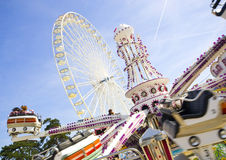 Merry-go-round. In a funfair at paris, with big wheel behind Stock Photography