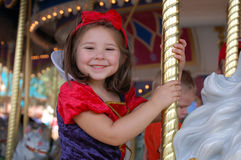 Merry Go Round. Four year old girl riding a merry go round Royalty Free Stock Photography