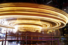 Merry go round. A merry go round in motion blur of lights inside a amusement place Stock Images