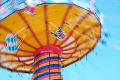 Merry Go Round. A merry go round in action. Kids are swinging royalty free stock photo