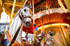 Merry-go-round. A white horse on a colourful merry-go-round Stock Images