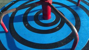 Merry go round. Blue and black merry go round spinning in sunny outdoor park stock video