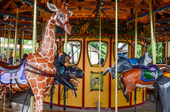 Merry Go Round. Bright colorful fun merry-go-round at a ammusement park children and adults ride for entertainment Stock Images