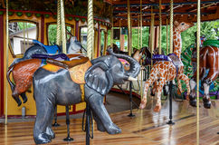 Merry Go Round. Bright colorful fun merry-go-round at a ammusement park children and adults ride for entertainment. Carrousel Royalty Free Stock Images