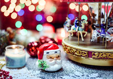 Merry Go Round and candles Christmas Decoration. Santa Claus,Merry Go Round and candles in the Christmas Decoration theme on the golden lighting background Royalty Free Stock Photos