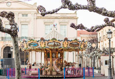 Merry-go-round carousel roundabout on a winter fair in front of Royalty Free Stock Image