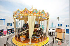 Merry-go-round (carousel) in The Santorini Park, Thailand Stock Photography