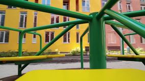 Merry-go-round on childrens playground stock video footage