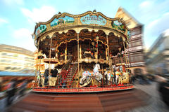 Merry-go-Round in Christmas Market in daytime Stock Photo