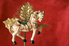Merry-go-round christmas ornament horse. For decorate on red background Royalty Free Stock Images