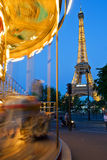 Merry-go-round and Eiffel Tower Stock Images