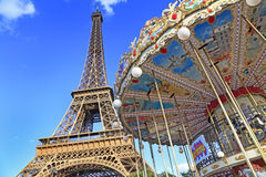Merry-go-round and Eiffel Tower in Paris Royalty Free Stock Photos