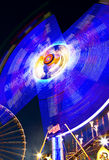 Merry go round with ferris wheel in the background Royalty Free Stock Images