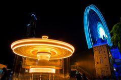 Merry go round and Ferris wheel at night in Asiatique, Bangkok, Thailand. royalty free stock images