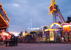 Merry Go Round and Flume Rides in Paris. Early evening time lapse of a funfair in Paris, France Stock Photos