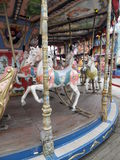 Merry-go-round at the fun fare. Horse riding on a merry-go-round in an amusement park in Blackpool, UK Stock Image