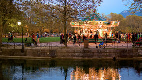 Busy carousel after dusk. A fun family ride in the French town of Annecy Stock Photo