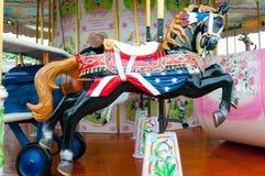 Merry-go-round horse. A brightly coloured merry go round horse Stock Photos