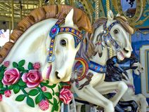 Merry Go Round Horses, Midway Carnival Ride. Three horses on a Merry Go Round. This merry-go-round used to be part of a traveling circus Royalty Free Stock Photos