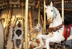 Merry-go-round with horses in warm tone Royalty Free Stock Images