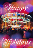 Merry-Go-Round illuminated at night. New year greeting on background with blurred carousel and bokeh. Merry Christmas and Happy Ne Royalty Free Stock Photo
