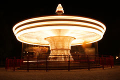 Merry-Go-Round in motion illuminated at night Stock Images