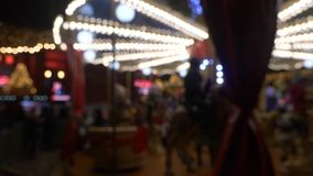 Merry go round at night blurred. Merry go round at night market spinning with people stock video