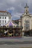 Merry-Go-Round and Palais de la Mutualité Royalty Free Stock Image