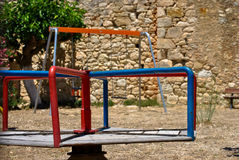 Merry Go-Round. Playground outside the Izzeddin Fortress near the village of Kalami, Souda Bay Crete, Greece Stock Photo
