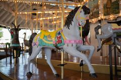 Merry go round pony carousel at the park. royalty free stock images