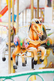Merry-go-round retro carousel horses covered with Royalty Free Stock Photography