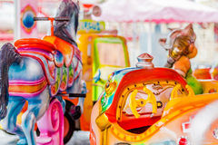 Merry-go-round seats Stock Image