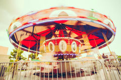 Merry-Go_Round Spinning at amusement park Royalty Free Stock Photography