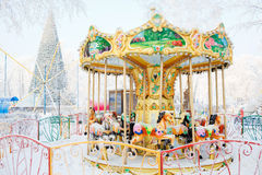 Merry-go-round traditional horses covered with Stock Image