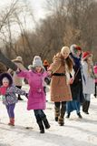Merry-go-round during winter carnival Maslenitsa in Russia Stock Photos