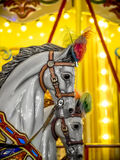 Merry-go-round wooden horses Stock Images